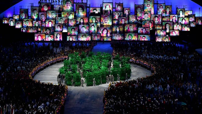 Dancers perform during the opening ceremonies for the Rio 2016 Summer Olympic Games at Maracana.