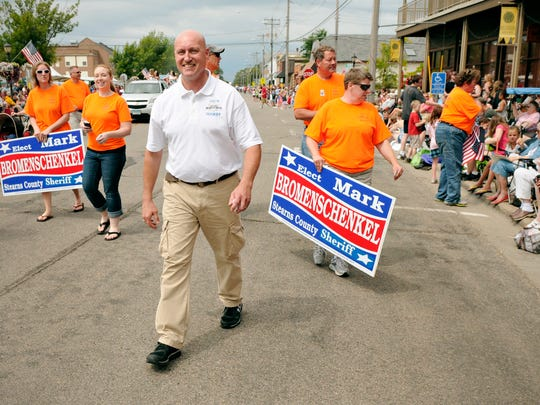 Mark Bromenschenkel walks the parade route with his campaign team during the St. Joseph Parade on July 4. Bromenschenkel is running for Stearns County sheriff.