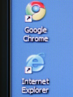 Google's Chrome browser shortcut is shown next to Microsoft's Internet Explorer browser shortcut during a news conference at Google headquarters in Mountain View, California.