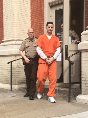 Devin Mergenthaler, 31, is led away Monday from the Augusta County Courthouse.