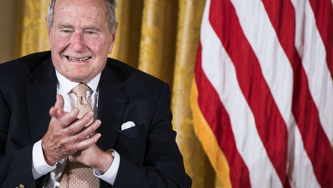 Former president George H. W. Bush, pictured here in 2013, will wear neck braces as he recovers from a fall earlier this month.