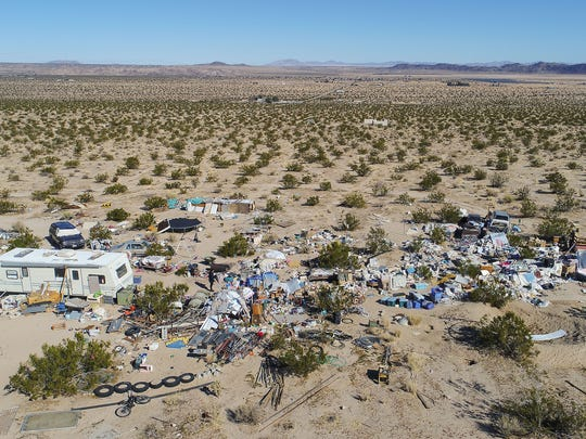 The parents of three children were arrested in Joshua Tree when the San Bernardino County Sheriff's department found the family living in the open desert, March 1, 2018.