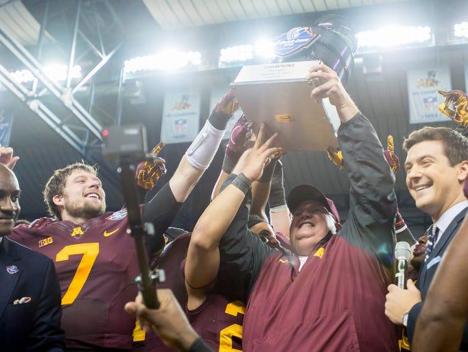 Minnesota head coach Tracy Claeys, center, celebrates