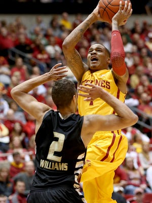 Iowa State guard Sherron Dorsey-Walker goes up for a shot over Oakland forward Dante Williams during the first half an NCAA college basketball game, Friday, Nov. 14, 2014, in Ames, Iowa.