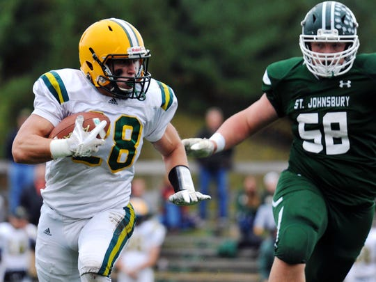 BFA-St. Albans running back Nate Parady races St. J defender Tom Emery to the edge during a matchup of Division I unbeatens at Fairbanks Field on Saturday, Sept. 30, 2017. The Hilltoppers rallied for a 36-28 victory.