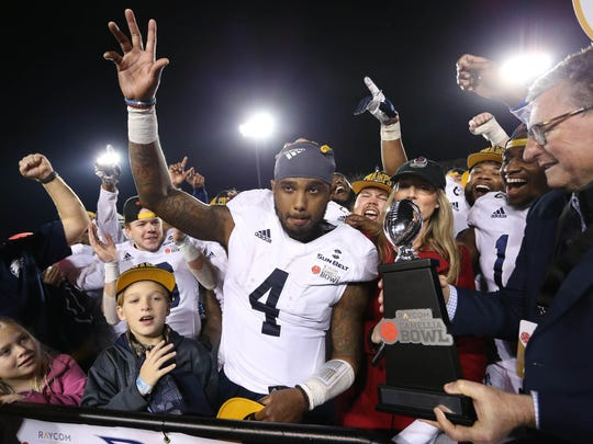 Georgia Southern Eagles quarterback Shai Werts (4) receives the MVP award after his team defeated the Eastern Michigan Eagles at Cramton Bowl Stadium in Montgomery, Ala., on Dec. 15, 2018.
