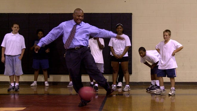 """Eugene Blalock, the principal at Mt. Healthy North Middle School, """"pinch hits"""" during a game of kick-ball"""