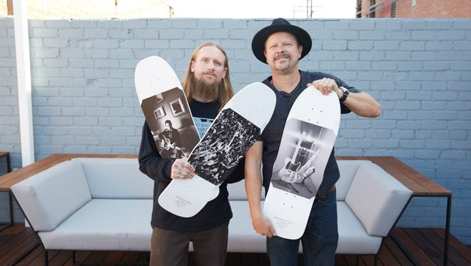 Mike Vallely and Danny Clinch holding their limited-edition boards.
