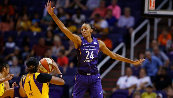Phoenix Mercury forward DeWanna Bonner (24) guards Los Angeles Sparks guard Odyssey Sims (1) during a WNBA game at Talking Stick Resort Arena in Phoenix on August 12, 2018