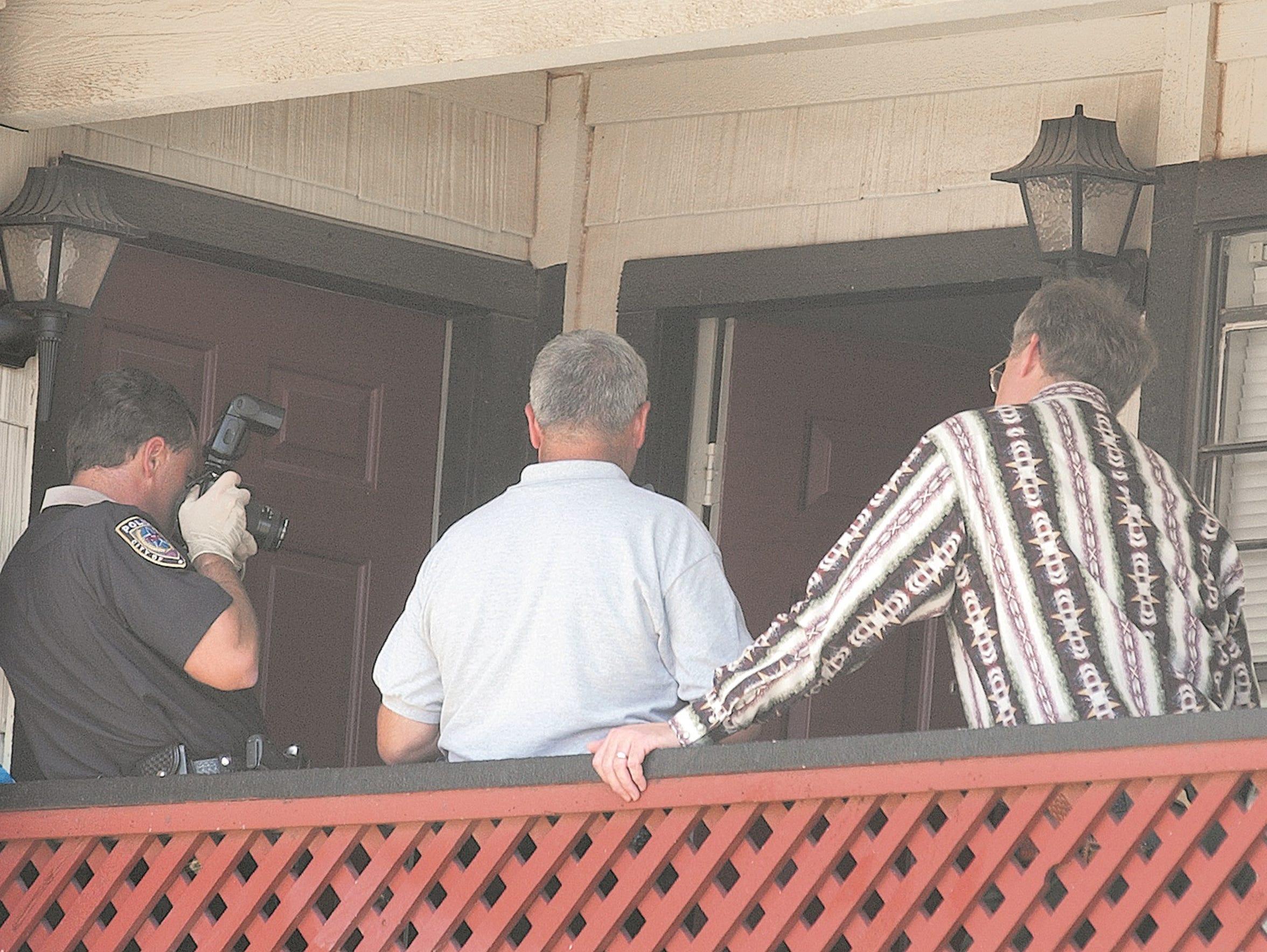 Abilene police take photos of the apartment where Jennifer