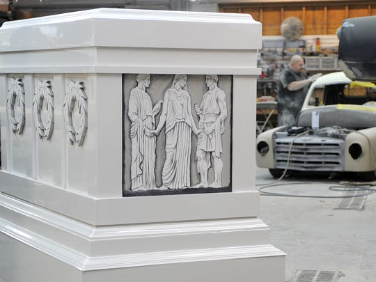 A refurbished replica of the Tomb of the Unknown Soldier rests in the middle of Elite Autoworks' garage space Monday morning. Ryan McKenna, owner of Elite Autoworks, and his employees donated more than 120 hours to restore the replica.