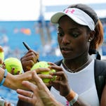 Aug 18, 2015; Cincinnati, OH, USA; Sloane Stephens (USA) signs autographs for fans on day four during the Western and Southern Open tennis tournament at Linder Family Tennis Center. Mandatory Credit: Aaron Doster-USA TODAY Sports