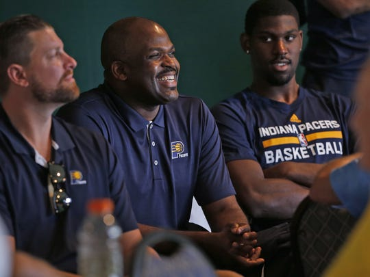 Pacers head coach Nate McMillan, center, smiles as
