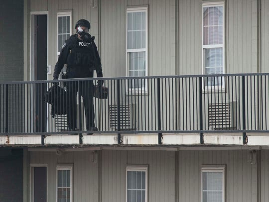 Police SWAT remove tools following a police standoff at Evansville Inn and Suites near Highway 41 on Friday, March 9, 2018. The police did use chemical agents during the standoff.