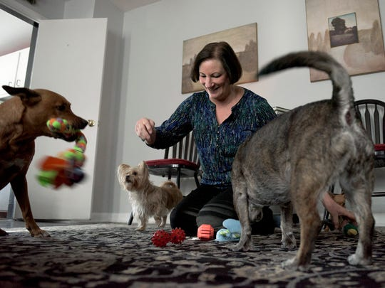 Eileen Boyle plays with her dogs Wednesday, Jan. 10, 2018 inside her home in Collingswood, N.J.