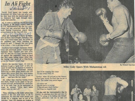 Dec. 5, 1976, The Commercial Appeal reports on heavyweight champion Muhammad Ali's appearance at the Muhammad Ali Theater at 380 Beale; the champ playfully sparred with Mike Cody (TOP), and Harold Ford (BOTTOM), who was joined in ring by young Harold Ford Jr.