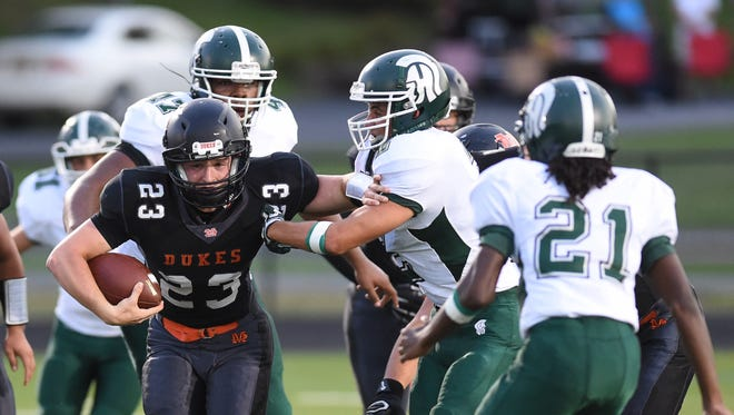 Marlboro's Phillip Desantis breaks through the Spackenkill defense during Friday's game at Marlboro.