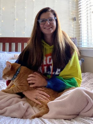 Kennedy Hoke, a senior at the University of Missouri, is in isolation with her cat Arthur while she recovers from an illness she believes to be COVID-19.