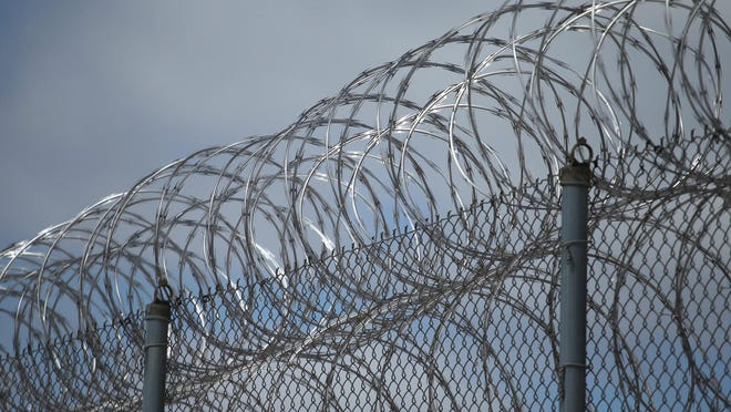 Razor wire tops one of the fences at the Lincoln Hills School and Copper Lake School complex in rural Irma in 2013.