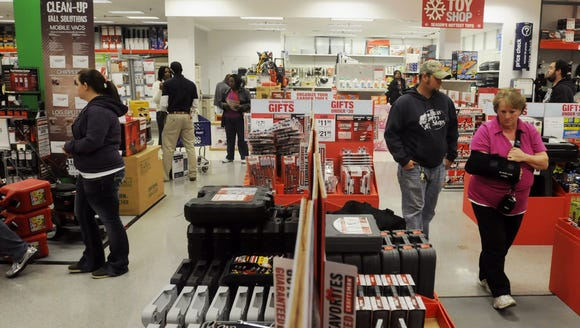 Black Friday shoppers look through Sears in Montgomery