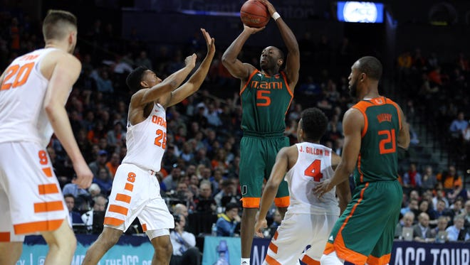 Miami guard Davon Reed (5) shoots during the Hurricanes' ACC tournament win over Syracuse last week. Reed leads Miami at 15 points per game.