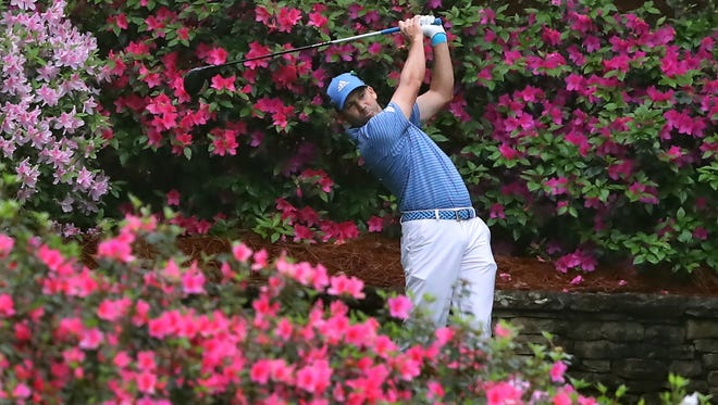 Defending Masters champion Sergio Garcia tees off on the 13th hole during his Wednesday practice round for the Masters at Augusta National Golf Club.