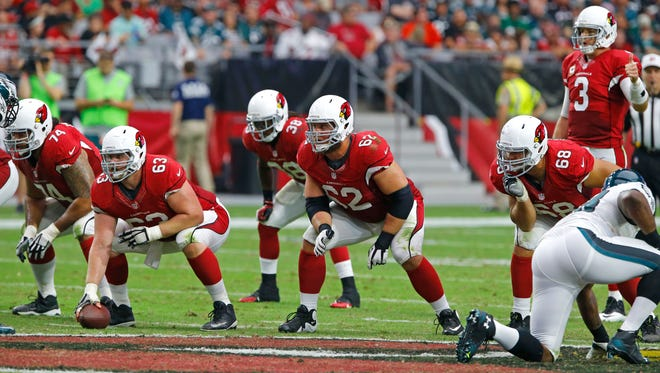 Arizona Cardinals guard Paul Fanaika (74), center Lyle Sendlein (63), guard Ted Larsen (62) and  tackle Jared Veldheer (68) protect quarterback Carson Palmer in  their 24-20 win over the Philadelphia Eagles in their NFL game Sunday, Oct. 26, 2014 in Glendale.