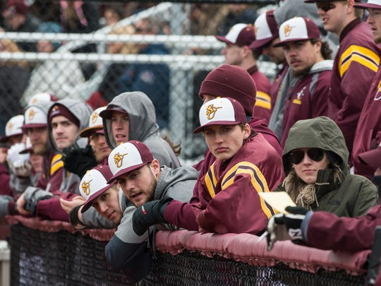 Salisbury University players watch their team from the dugout during a game against Cortland on Saturday, Feb. 17, 2018.