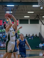 Pennfield's Alicia Lake (24) goes for the hoop during