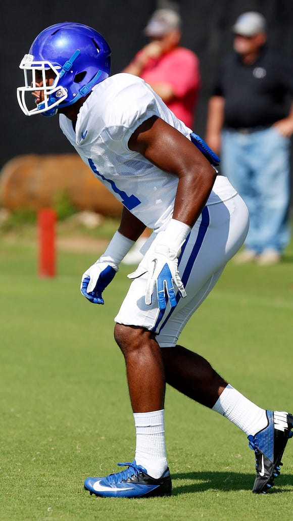 Kentucky's A.J. Stamps practices on campus in Lexington.  Aug. 12, 2014