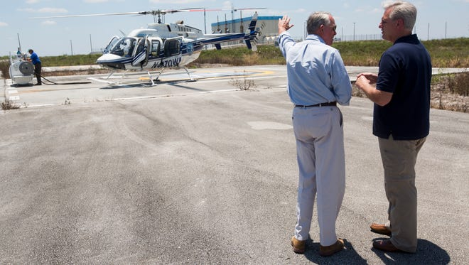 Representative Francis Rooney, left, speaks with House Majority Leader Kevin McCarthy during a pit stop for fuel just west of US-27 and north of I-75 during an aerial tour of the Lake Okeechobee watershed and surrounding Everglades Restoration Project Tuesday, May 9, 2017.