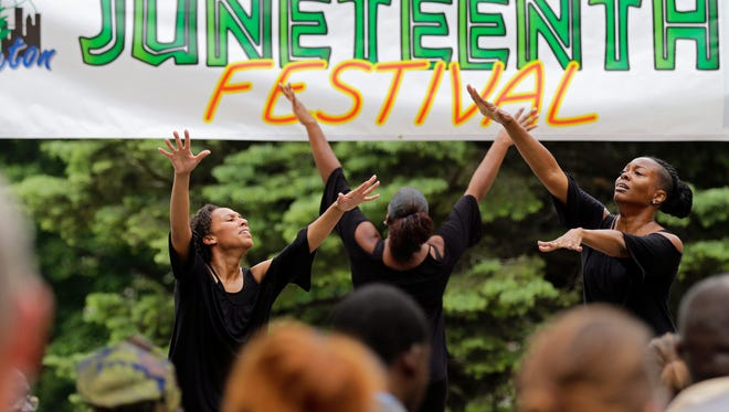 The Amazing Grace Dance Company performs during the Juneteenth celebration Sunday at City Park in Appleton.