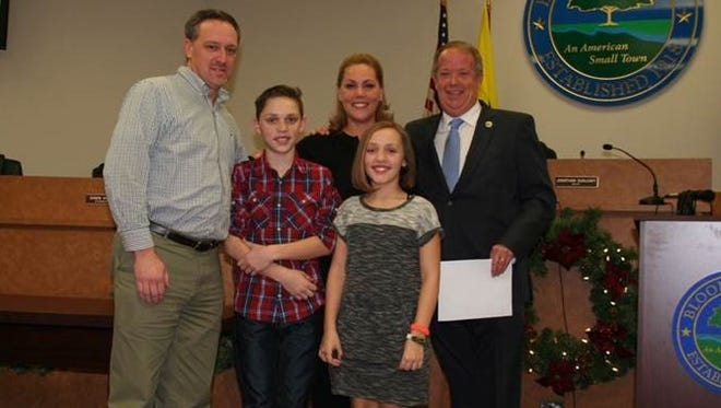 Bloomingdale Councilwoman Dawn Hudson with her family after being sworn into office. Pictured from left is Hudson's husband Mike (head of the OEM),  son Cole, daughter Bella, Hudson, and Mayor Jon Dunleavy.
