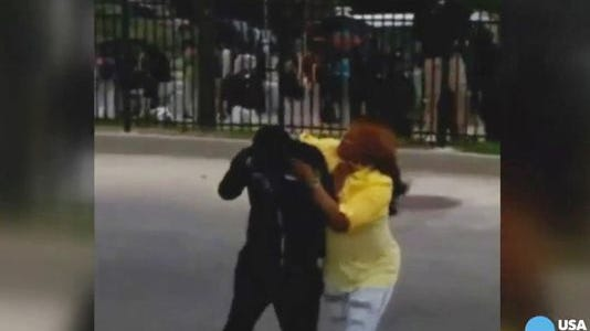 A woman disciplines her son after finding out he was taking part in rioting in Baltimore.