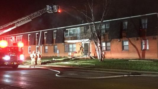 Firefighters at the scene of an apartment fire at 1011 N. Danz Ave. on Green Bay's northeast side early Tuesday.