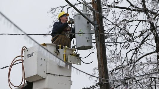 A Wisconsin Public Service worker repairs a line in this Gannett Wisconsin Media file photo.