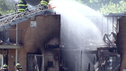Firefighters hit hot spots in units at the Ken Gardens Apartment complex off Matawan Avenue in Aberdeen Friday.