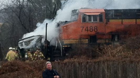 Emergency personnel respond to a freight train that hit a car carrier on Western Highway in West Nyack on Dec. 6, 2014.