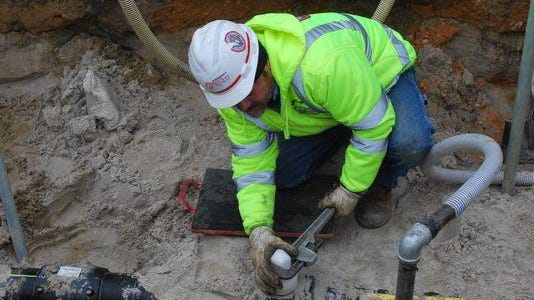 New Jersey Natural Gas said customers will get a bill credit this coming winter. Carlos Rojas, a New Jersey Natural Gas foreman, works on a gas valve on a 6-inch distribution main during the repressurization of Long Beach Island following superstorm Sandy.