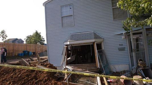 A Sandy-damaged home that was being raised fell from about 12 feet off the ground