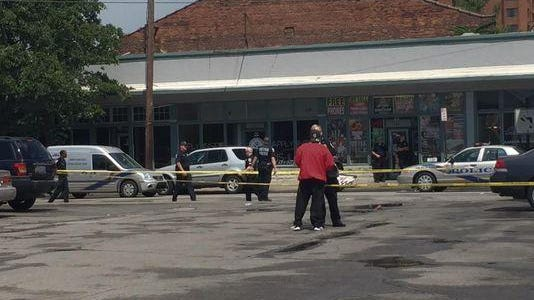 Police investigating shooting at 3rd and Oak Streets on Saturday, June 13, 2015.