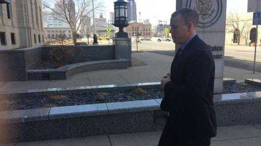 Former Des Moines Police Officer Colin Boone walks to a courthouse in this file photo.