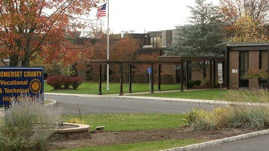 Somerset County Vocational and Technical High School in Bridgewater has paid $110,000 to settle a lawsuit brought by a former gay Spanish teacher, alleging he was the victim of a hostile work environment and retaliation.