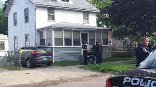 Burlington police investigate the scene at 54 Ward St. where two dead bodies were found June 18.