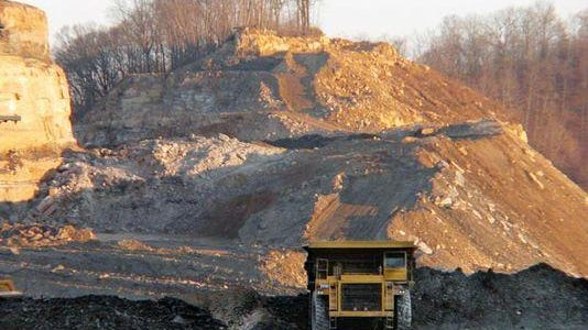 A dump truck moved dirt and rock at a mountaintop-removal coal mine near Hazard.