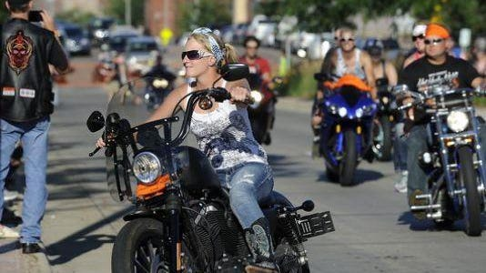 Motorcyclists take part in the Hot Harley Nights parade in downtown Sioux Falls on July 12, 2014.