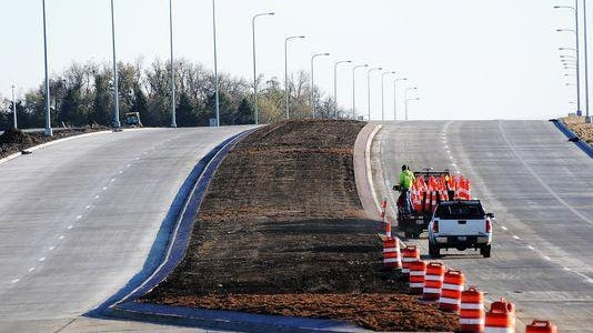 Construction crews work on Powder House Road in 2013. The City Council wants to rename the road Veterans Parkway.