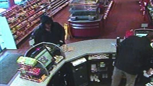 A surveillance image shows the purchase of a winning Hot Lotto ticket.