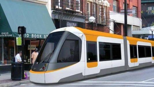 Rendering of Cincinnati's streetcar running along Main Street in Downtown.