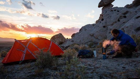A man camping in this undated photo from the newly designated Basin and Range National Monument.